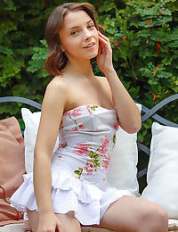 Innocent teen Una Piccola takes off her ruffle dress and underwear on a bench