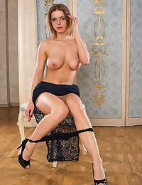 Hot big titted Yelena lifts her black lace skirt to show her shaved pussy