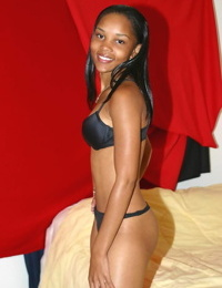 Young looking black girl Cali fingers spreads her damp slit after disrobing