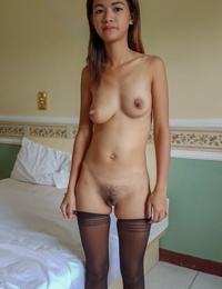 Young Asian girl Lyka takes a facial cumshot after fucking in black stockings