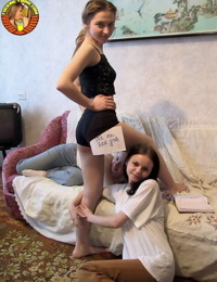Teen girls have a shared lesbian experience in one of their parents bedroom