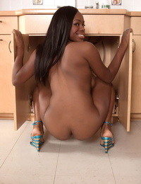 Hot black girl Stacey Foxx exposes her fine ass while getting naked